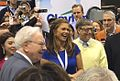 Kathy Ireland, Warren Buffett and Bill Gates at the 2015 Berkshire Hathaway Shareholders Meeting.jpg