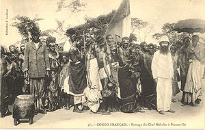 History of the Republic of the Congo - King Makoko of Téké (center left carried on chair) in procession to Brazzavile with French colonials, circa 1905.