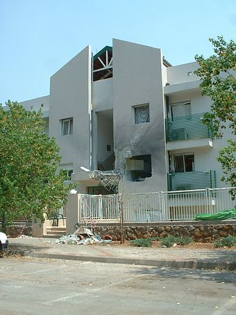 Structural damage of a residential building in Kiryat Shmona after being hit by a rocket KiryatShmona Rocket Damage.JPG