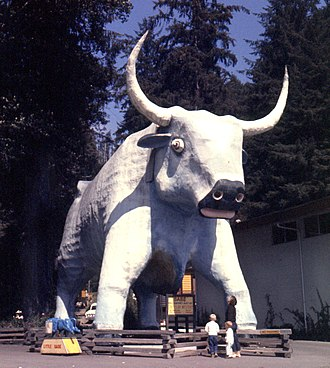 Tall tale - Paul Bunyan's sidekick, Babe the blue ox, sculpted as a ten-meter tall roadside tourist attraction