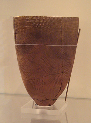 Jeulmun pottery period - Korean earthenware vessel in the classic Jeulmun comb-pattern style. Various patterns cover the majority of the vessel surface. Ca. 4000 BC, Amsa-dong, Seoul. British Museum.