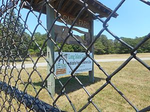 Long Island Game Farm - Sign for the Long Island Game Farm off of Chapman's Boulevard; June 25, 2016.