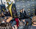 Lara Bingle and Sam Worthington on 2014 AACTAS Awards red carpet (1).jpg