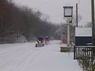 The Street, Lawshall - The Lawshall Swan sign in a snow-storm.