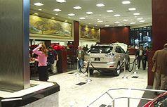 Interior of a Lexus dealership, featuring indoor steel waterfall.