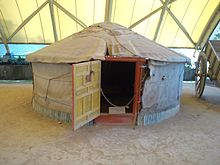 Yurt-shaped tent under cover