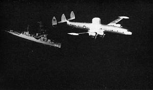 USS Harveson (DE-316) - Harveson and a WV-2 in 1957.