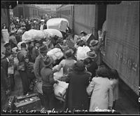 Los Angeles, California. Evacuees of Japanese ancestry entraining for Manzanar, California, 250 mil . . . - NARA - 536765