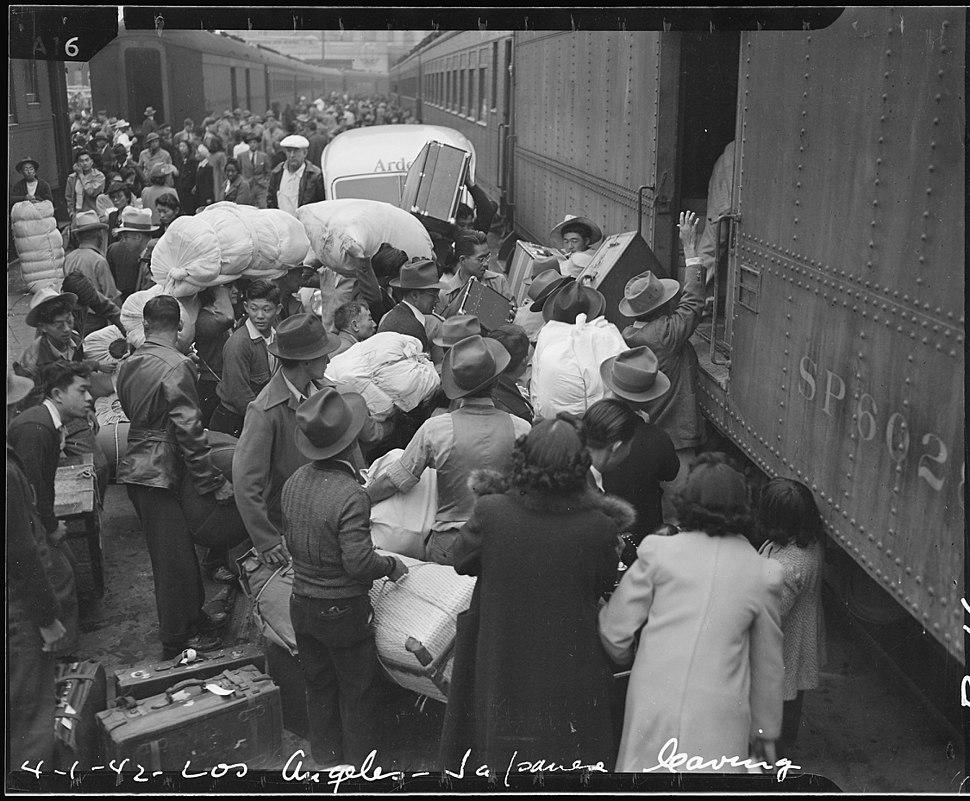 Los Angeles, California. Evacuees of Japanese ancestry entraining for Manzanar, California, 250 mil . . . - NARA - 536765