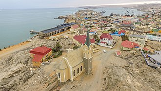 Lüderitz - An aerial view of Lüderitz with the Felsenkirche in the foreground and the rest of the town in the background