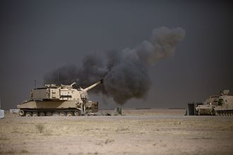Battle of Mosul (2016–2017) - A U.S. Army M109A6 Paladin conducts a fire mission at Qayyarah Airfield West, in support of the Iraqi security forces' push toward Mosul, 17 October 2016.