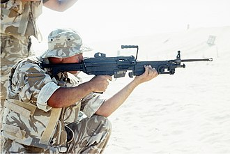 1st The Queen's Dragoon Guards - A soldier from the Queen's Dragoon Guards fires an FN Minimi