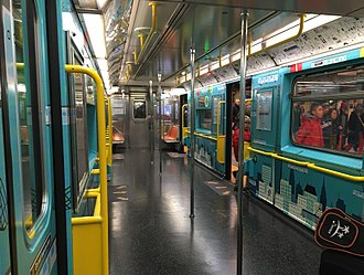 42nd Street Shuttle - The interior of a R62A subway car used on the 42nd Street Shuttle, which was retrofitted to increase capacity