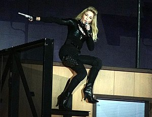 """Controversy of The MDNA Tour - Madonna performing """"Gang Bang"""" during the show's first segment, This performance received negative backlash due to the involvement of firearms"""