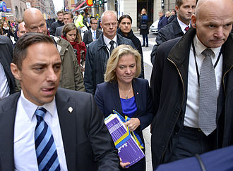 Swedish Security Service - Säpo close protection officers surrounding the Minister for Finance in 2014.