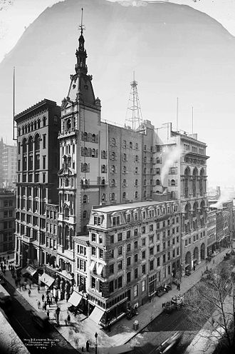 New York Evening Mail - The Mail and Express building (1892–1920, center, with spire)