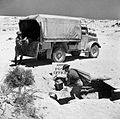 Mail being unloaded from an Army Post Office lorry in the Western Desert, 16 July 1941. E4175.jpg