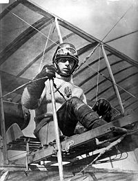 Major Alexander Procofieff de Seversky sits at the controls of an early aircraft, circa 1914.jpg