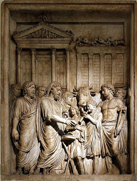Marcus Aurelius as pontifex offers sacrifice to Jupiter Capitolinus in gratitude for victory. Once part of the Arch of Marcus Aurelius. Capitoline Museum, Rome. Marcus Aurelius showing sacrifice - Arch of Marcus Aurelius - Musei Capitolini - Rome 2016.jpg