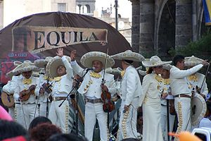 Tequila Express - Mariachis on stage in Guadalajara in front of a Tequila Express banner