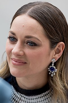 Marion Cotillard won for playing Edith Piaf in La Vie en Rose (2007); the first person to win for a French-language film. Marion Cotillard at 2019 Cannes.jpg