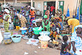 Market in Gambia with a lot of people with fruits.jpg