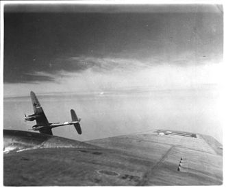 Messerschmitt Me 410 - An Me 410A-1/U4 with a BK 5 cannon peels off during attack on USAAF B-17s