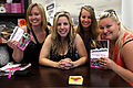 "Melissa Davis, left, Mollie Gross, center left, Abby Smith, center right, and Brianna Caskey, right, hold Gross' novel, ""Confessions of a Military Wife"" during the Live, Laugh and Learn book signing event at 130419-M-LD192-029.jpg"