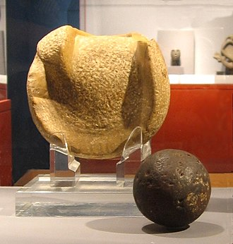 Mesoamerican rubber balls - A solid rubber ball used (or similar to those used) in the Mesoamerican ballgame, 300 BCE to 250 CE, Kaminaljuyu. The ball is 3 inches (almost 8 cm) in diameter, a size that suggests it was used to play a handball game. Behind the ball is a manopla, or handstone, which was used to strike the ball, 900 BCE to 250 CE, also from Kaminaljuyu.