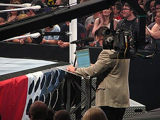 Michael Cole (wrestling) - Cole reads an email from the Anonymous General Manager