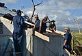 Military Sealift Command crew members assigned to the dry cargo and ammunition ship USNS Charles Drew (T-AKE 10) repair a roof in Ormoc, Philippines, Nov. 16, 2013, while supporting Operation Damayan 131116-N-ZT599-123.jpg