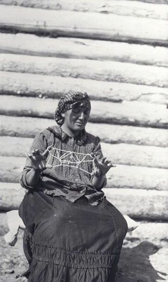 Long Lake 58 First Nation - Mme Hitchen with string bear, 1916