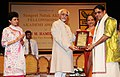 Mohd. Hamid Ansari presenting the Sangeet Natak Akademi Award-2010 to Shri Nagai R. Murlidharan, Chennai, for his outstanding contribution to Carnatic Instrumental Music (Violin).jpg