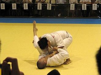 Kosen judo - Sankaku-jime (三角絞) applied at a modern kosen judo tournament in 2010.