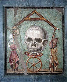 Symbolism of Fortuna's wheel divine justice and Skull mortality in a Pompeiian mosaic