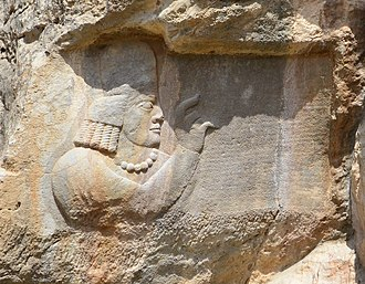 Timeline of the Sasanian Empire - An inscription of Kartir, with a relief of him holding the text