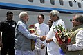 Narendra Modi being welcomed by the Governor of Odisha, Shri S.C. Jamir and the Chief Minister of Odisha, Shri Naveen Patnaik, in Odisha. The Union Minister for Mines and Steel, Shri Narendra Singh Tomar is also seen.jpg