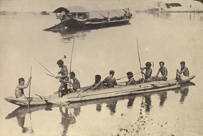 Original caption (cropped out): Native boats a...