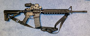 "Norinco CQ - Norinco CQ-A semi-automatic rifle with 20"" barrel sold in the Canadian civilian market. Shown with an EOTech style sight and Magpul furniture."