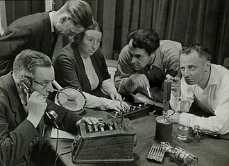Recording a radio play in the Netherlands (1949; Spaarnestad Photo). Opname van een hoorspel Recording a radio play.jpg
