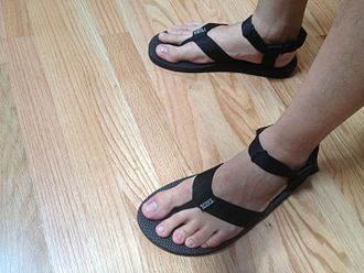Deckers Outdoor Corporation - An example of the original pair of Teva sandals, which featured a thong between the toes.