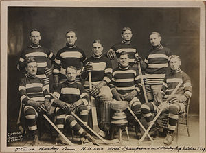Fred Lake (ice hockey) - Fred Lake, sitting above the Stanley Cup, with the Ottawa Senators in 1911.