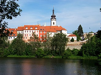 Písek - View of the Church of the Nativity of the Blessed Virgin Mary, town walls and Otava River