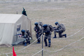 PMR Special Forces behind a tent.png