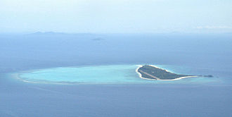 Reef - Pamalican island with surrounding reef, Sulu Sea, Philippines.