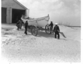 Pea Island USCG station, lifeboat and boathouse, 1942.PNG
