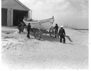 Pea Island Life-Saving Station - Pea Island USCG crewmen in 1942, showing lifeboat and boathouse