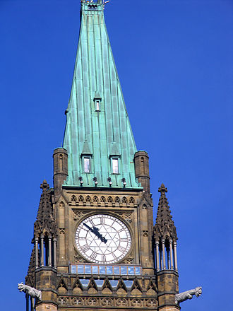 Peace Tower - South clock face and the glass windows of the observation deck below