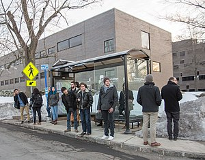 Bus stop - Moments before the bus arrives, riders wait at State University of New York at Purchase.