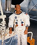 Pete Conrad poses with his right hand on a Central Station mock-up.jpg